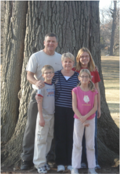 Jeff, Victoria, and the Grands pose with the great Oak at Rockhill Park.
